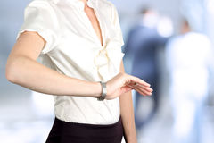Businesswoman checking time on her watch Stock Images