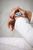 Businesswoman checking time Royalty Free Stock Image