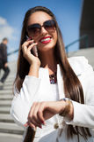 Businesswoman checking time Royalty Free Stock Photography