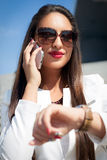 Businesswoman checking time Royalty Free Stock Photo