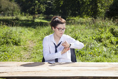 Businesswoman checking what time. Business woman checking what time royalty free stock photos
