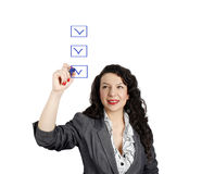 Businesswoman and checklist Stock Image