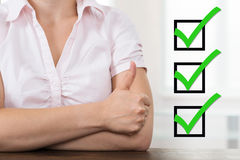 Businesswoman With Checklist Showing Thumb Up Royalty Free Stock Images