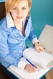 Businesswoman checks the documents in a folder stock image