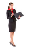 Businesswoman checks something in black folder. Young and attractive businesswoman in red shirt and jacket check something in black folder, studio shoot isolated Stock Photo