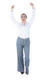 Businesswoman cheering with arms up Royalty Free Stock Images