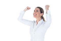 Businesswoman cheering with arms up Stock Photography