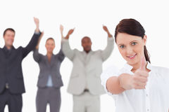 Businesswoman with cheering colleagues Royalty Free Stock Images