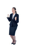 A businesswoman cheering and yelling Royalty Free Stock Images