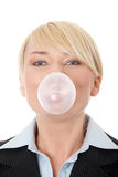 Businesswoman chewing a gum Royalty Free Stock Photo