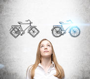 Businesswoman choosing bike Stock Image