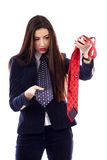 Businesswoman choosing between blue and red necktie Royalty Free Stock Images