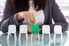Free Businesswoman Choosing Green Chair Among White Chairs In A Row Stock Image - 214507541