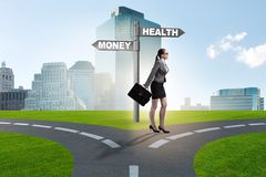 The businesswoman choosing between money and health stock photos