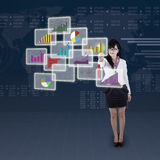 Businesswoman choosing one business chart Stock Photo