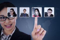 Businesswoman choosing partner on virtual screen Royalty Free Stock Images