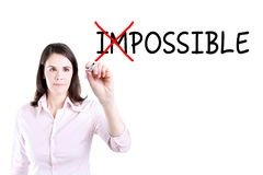 Businesswoman choosing Possible instead of Impossible. Stock Images