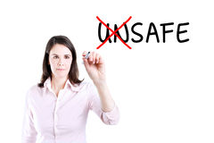 Businesswoman choosing Safe instead of Unsafe. Royalty Free Stock Images