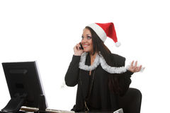 Businesswoman in a christmas hat Royalty Free Stock Photos