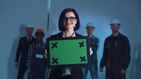 Businesswoman with chromakey plate stock footage