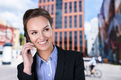 Businesswoman in the city centre Stock Photography