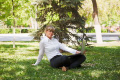 Businesswoman in a city park Royalty Free Stock Photography