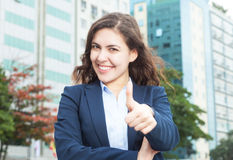 Businesswoman in the city showing thumb Royalty Free Stock Photos
