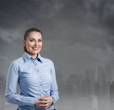 Businesswoman with a cityscape in the background Royalty Free Stock Images