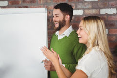 Businesswoman clapping in office Stock Photos