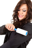 Businesswoman cleaning dust with lint roller Stock Photo