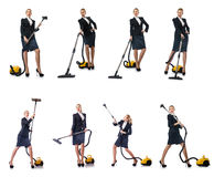 The businesswoman cleaning with vacuum cleaner on white Stock Photo