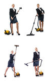 The businesswoman cleaning with vacuum cleaner on white Stock Image