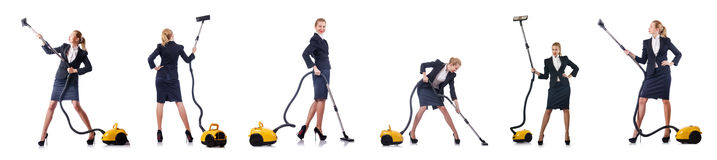 The businesswoman cleaning with vacuum cleaner on white Stock Images