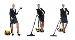 The businesswoman cleaning with vacuum cleaner on white Royalty Free Stock Image