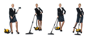 The businesswoman cleaning with vacuum cleaner on white Royalty Free Stock Photo