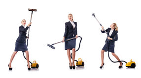 The businesswoman cleaning with vacuum cleaner on white Royalty Free Stock Images