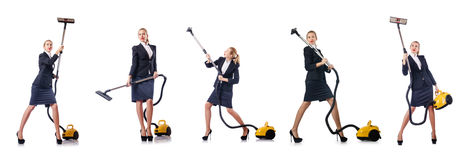 The businesswoman cleaning with vacuum cleaner on white Stock Photography