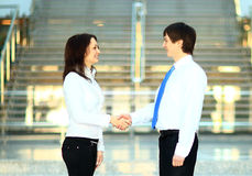 Businesswoman and client handshaking Royalty Free Stock Images