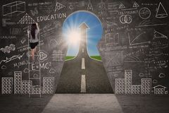 Businesswoman climbing on blackboard with success road Stock Images
