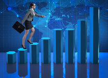The businesswoman climbing career ladder as trader broker Royalty Free Stock Photography