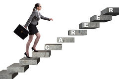 The businesswoman climbing career ladder in business concept Royalty Free Stock Image