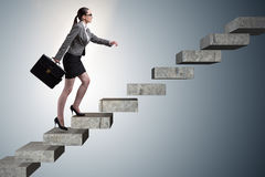 The businesswoman climbing career ladder in business concept Royalty Free Stock Photos