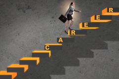 The businesswoman climbing career ladder in business concept Royalty Free Stock Photography