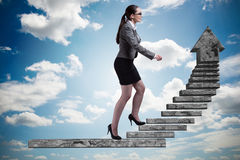 The businesswoman climbing career ladder concept Royalty Free Stock Photography