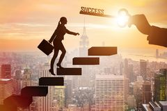 The businesswoman climbing the career ladder of success Stock Photography