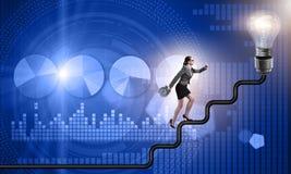 The businesswoman climbing career ladder towards light bulb Stock Photography