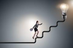 The businesswoman climbing career ladder towards light bulb Stock Photos