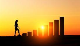 Businesswoman climbing chart bars Royalty Free Stock Image