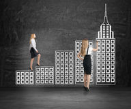 Businesswoman climbing city ladder Stock Images