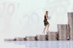 Businesswoman climbing money stairs. Career concept Stock Photography